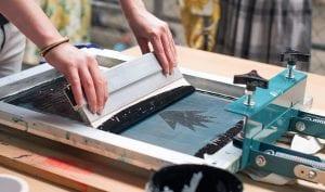 A Worker Screen Printing Shirt