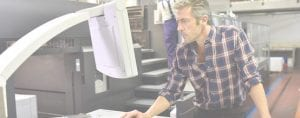 A Man Operating a Screen Printer